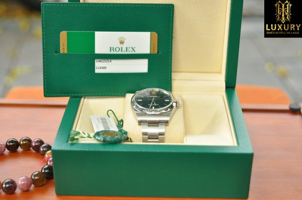 Đồng hồ Rolex Oyster Perpetual Steel 114300 mặt xanh - HT Luxury